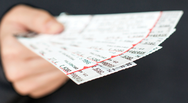 a hand holding tickets