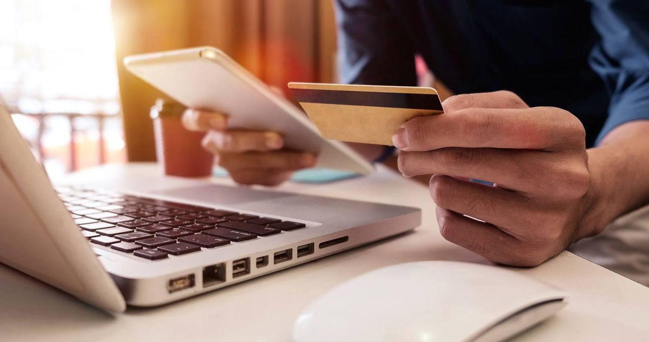 man buying online using his card