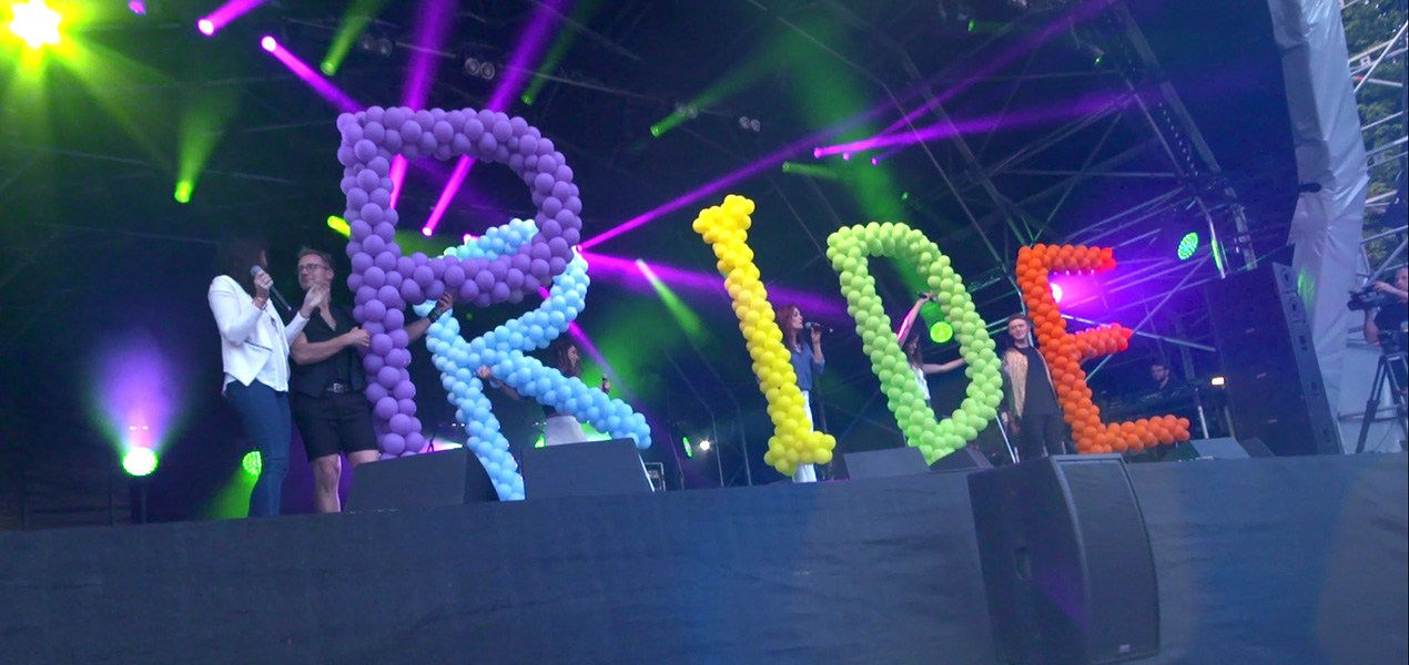 performers with Pride balloons