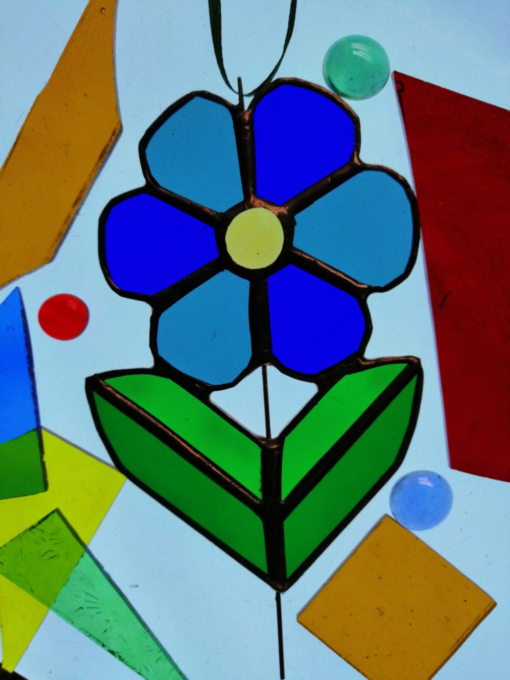 Get Into Art Create a stained glass flower sun catcher. banner image
