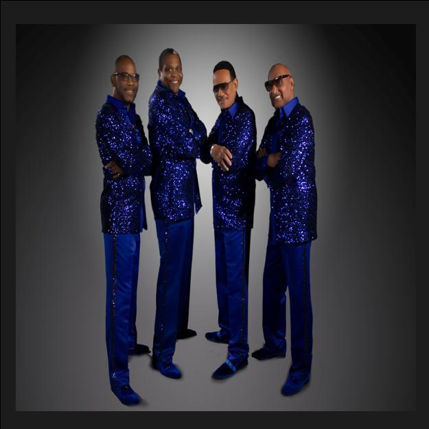 The legendary FOUR TOPS live on stage. banner image